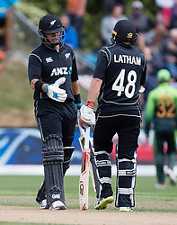 New Zealand's Ross Taylor, left, is congratulated by Tom Latham after scoring 50 against Pakistan in the third one day cricket international at the University of Otago Oval, Dunedin, New Zealand, Saturday, January 13, 2018. Credit:SNPA / Adam Binns ** NO ARCHIVING**