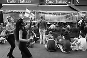 Girls with flag singing, Ten German bombers, a song about shooting down German planes by the RAF, Watching football match between England and Croatia, Leicester Sq. London, 11 July 2018
