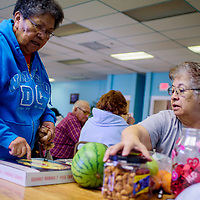 Mary DeLaO, right, takls with Esther Gatewood at a raffle to raise funds for the senior olympics team at the North Side Senior Center in Gallup Thursday.