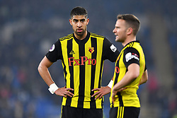 Watford's Adam Masina (left) looks on during the Premier League match at the Cardiff City Stadium.