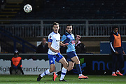 Wycombe Wanderers midfielder Nick Freeman (22) crosses under pressure during the The FA Cup match between Wycombe Wanderers and Tranmere Rovers at Adams Park, High Wycombe, England on 20 November 2019.