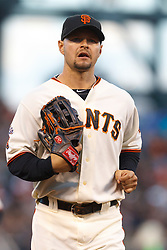 May 25, 2011; San Francisco, CA, USA;  San Francisco Giants right fielder Cody Ross (13) returns to the dugout during the third inning against the Florida Marlins at AT&T Park. Florida defeated San Francisco 7-6 in 12 innings.