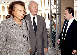 File photo - Liliane Bettencourt, the daughter of L'Oreal founder Eugene Schueller, and her husband Andre Bettencourt arrive to a mass in honour of the late Francois Dalle, former chief executive of French cosmetics company L'Oreal, held at the Invalides in Paris, France, on September 8, 2005. Francois Dalle, who was the company's chief executive for 27 years and credited with transforming it into a global giant, has died aged 87 on August 9, 2005 in Geneva, Switzerland. Liliane Bettencourt has died aged 94 it was announced on September 21, 2017. Bettencourt was the richest person in France and the third-richest woman in the world with a net worth of $40 billion. She was the sole heir to L'Oreal, the largest cosmetics company in the world, which was started by her father, and a large shareholder in Nestle. Nearly a decade ago a trial forced Liliane's personal business into the public light, laid bare her obsession with a flashy homosexual photographer whom she turned into a billionaire, destroyed her relationship with her daughter, turned a long time family butler against her, and, finally, turned the dowager heiress into even more of a recluse than she had been before. Photo by Gorassini-Klein/ABACAPRESS.COM