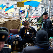 December 19, 2013 - Kiev, Ukraine: Pro-EU demonstrators sit beside a barricade on a road leading to Independence Square.<br /> On the night of 21 November 2013, a wave of demonstrations and civil unrest began in Ukraine, when spontaneous protests erupted in the capital of Kiev as a response to the government&rsquo;s suspension of the preparations for signing an association and free trade agreement with the European Union. Anti-government protesters occupied Independence Square, also known as Maidan, demanding the resignation of President Viktor Yanukovych and accusing him of refusing the planned trade and political pact with the EU in favor of closer ties with Russia.<br /> After a days of demonstrations, an increasing number of people joined the protests. As a responses to a police crackdown on November 30, half a million people took the square. The protests are ongoing despite a heavy police presence in the city, regular sub-zero temperatures, and snow. (Paulo Nunes dos Santos/Polaris)
