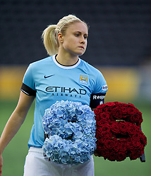 WIDNES, ENGLAND - Thursday, April 17, 2014: Manchester City Ladies captain Steph Houghton with flowers remembering the 96 victims of the Hillsborough Stadium disaster before the FA Women's Super League match agains Liverpool at the Halton Stadium. (Pic by David Rawcliffe/Propaganda)