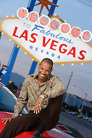 Man sitting on bonnet of car in Las Vegas