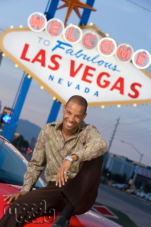 Man sitting on bonnet of car in Las Vegas