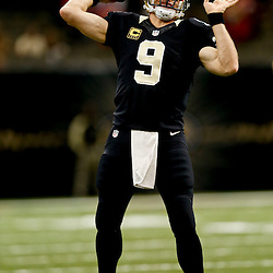 Nov 17, 2013; New Orleans, LA, USA; New Orleans Saints quarterback Drew Brees (9) prior to a game against the San Francisco 49ers at Mercedes-Benz Superdome. Mandatory Credit: Derick E. Hingle-USA TODAY Sports