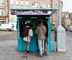 Small kiosk selling Scottish snacks called The Haggis Box, on Grassmarket square in Edinburgh Old Town, Scotland, UK