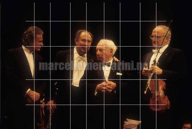 "Venice, Palafenice, 1996. Concert on the occasion of the prize ""A life for music"" given to Isaac Stern: organist Giorgio Carnini, flutist Jean-Pierre Rampal, violinists Isaac Stern and Salvatore Accardo / Venezia, Palafenice, 1996. Concerto in occasione del premio ""Una vita per la musica"" dato a Isaac Stern: l'organista Giorgio Carnini, il flautista Jean-Pierre Rampal, i violinisti Isaac Stern e Salvatore Accardo  - © Marcello Mencarini"
