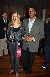 The HON.IMOGEN LLOYD WEBBER daughter of Andrew Lloyd Webber and MR DARRYL SAMARAWEERA at the opening party of Pengelley's, 164 Sloane Street, London SW1 on 22nd February 2005.<br />