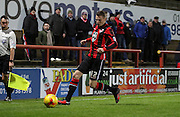 Paul Mullin attacks during the Sky Bet League 2 match between Morecambe and Cambridge United at the Globe Arena, Morecambe, England on 24 November 2015. Photo by Pete Burns.