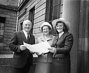 "07/06/1973.06/07/1973.07 June 1973.The president of the Incorporated Law Society,Mr. T. V. O'Connor presented parchments to young solicitors at the Four Courts, Dublin on Thursday. Picture shows Miss Goretti Hickey, B.C.L. who received her parchment from the President of the Incorporated Law Society, showing the parchment to her parents, Mr. J.B. Hickey, Cork County Solicitor and Mrs Hickey of ""Shalimar"", Hettyfield, Douglas, Co. Cork after the ceremony"