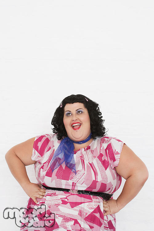 Overweight Woman posing with hands on hips