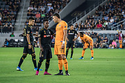 LAFC forward Latif Blessing (7) and Houston Dynamo forward Christian Ramirez (13) share a word during a MLS soccer game, Saturday, Sept 25, 2019, in Los Angeles. LAFC wins 3-1. (Jon Endow/Image of Sport)