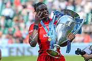 Saracens lock Maro Itoje (6) holds up 4 fingers as he holds the trophy during the Gallagher Premiership Rugby Final match between Exeter Chiefs and Saracens at Twickenham, Richmond, United Kingdom on 1 June 2019.