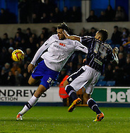 Picture by David Horn/Focus Images Ltd +44 7545 970036<br /> 28/01/2014<br /> Ryan Fredericks of Millwall (right) attempts to block a shot from Atdhe Nuhiu of Sheffield Wednesday during the Sky Bet Championship match at The Den, London.