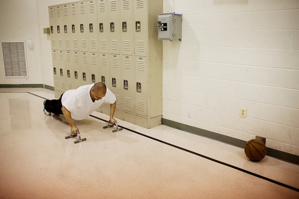 Ghentel Chambers does pushups at Maryhaven, a healthcare facility specializing in treatment for people with alcohol and drug dependencies in Columbus, Ohio on Tuesday, April 21, 2009. Patients are kept on a very regimented schedule which includes time for recreational activities.