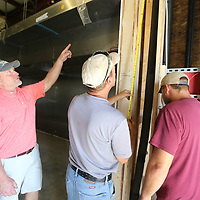 Darren Stafford, left, makes sure everything is being installed in the right location as he works to get the new Brick and Spoon location in Tupelo open.
