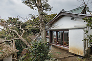 Oiso, Kanagawa prefecture, Japan, February 10 2017 - Keiji and Atsuko Suzuki's minka, traditional wooden house, is the last minka home in Oiso. The previous owner of the 3,000 sq. ft. house moved it from the shores of Lake Biwa, near Kyoto, 35 years ago. <br /> Main building (right) and detached house (left).