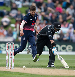 England's Mark Wood, left, attempts to run New Zealand's Ross Taylor out by kicking the ball to the wickets in the fourth one day cricket international at the University of Otago Oval, Dunedin, New Zealand, Wednesday, March 7, 2018. Credit:SNPA / Adam Binns ** NO ARCHIVING**