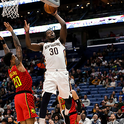 Mar 26, 2019; New Orleans, LA, USA; New Orleans Pelicans center Julius Randle (30) shoots over Atlanta Hawks forward John Collins (20) during the second half at the Smoothie King Center. Mandatory Credit: Derick E. Hingle-USA TODAY Sports