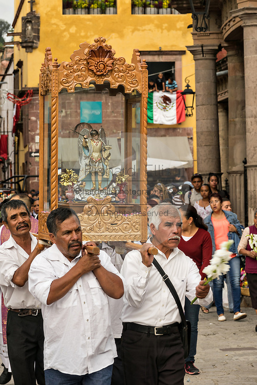 Devotees carry the statue of Saint Michael on their shoulders to the Parroquia de San Miguel Arcangel church during the week long fiesta of the patron saint Saint Michael September 26, 2017 in San Miguel de Allende, Mexico.