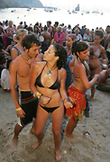 A happy couple dancing on the beach, Sunset beach party, Benirras Beach, Ibiza, July 2006