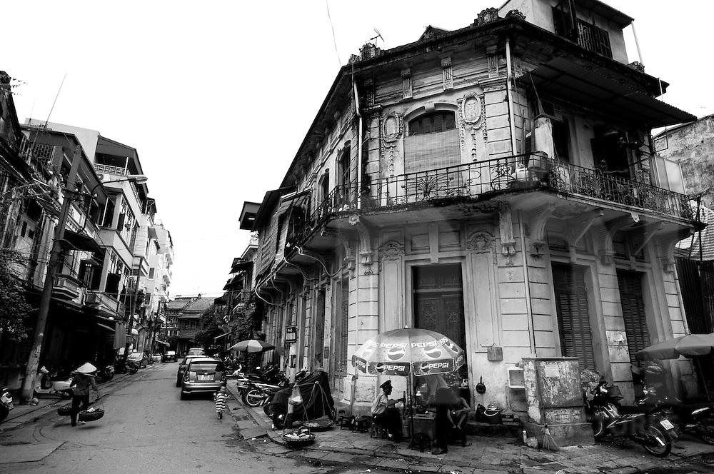 An Old Quarter street lined with Colonial-style buildings, Hanoi, Vietnam, Southeast Asia