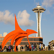 Seattle Art Museum Olympic Sculpture Park, crowd of people on opening day of sculpture park, Seattle, WA; Eagle sculpture, Alexander Calder, 1971, painted steel, gift to park by Jon and Mary Shirley