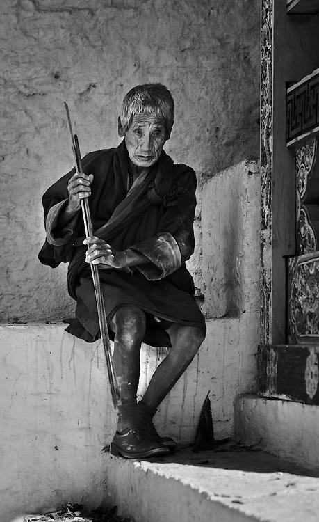 A blind monk resting at Trongsa Dzong, Bhutan.