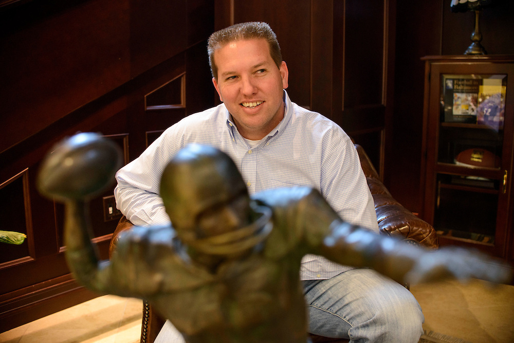 Photo by Matt Roth.Assignment ID: 10137590A..Chad Unitas, 34, sits in front of a statue of his father, Baltimore Colts Hall of Fame quarterback Johnny Unitas, in the lobby of the Baltimore Ravens' practice facility, where Chad Works, The Under Armour Performance Center in Owings Mills, Maryland on Wednesday, January 23, 2013.
