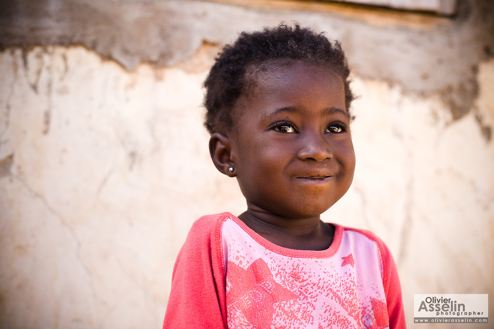 Portrait of a young gir in a pink t-shirt. Northern Ghana, Thursday November 13, 2008.