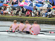 Henley, GREAT BRITAIN, Kingston RC, move past the Stewards Enclousure, as the crowd shelter under umbrellas, during a heat of the Wyfold Challenge Cup o the opening day of  the 2008 Henley Royal Regatta, on  Wednesday, 02/07/2008,  Henley on Thames. ENGLAND. [Mandatory Credit:  Peter SPURRIER / Intersport Images] Rowing Courses, Henley Reach, Henley, ENGLAND . HRR Umbrella's