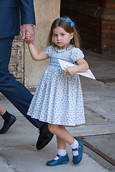 Princess Charlotte holding the hand of the Duke of Cambridge after attending Prince Louis's christening at the Chapel Royal, St James's Palace, London.