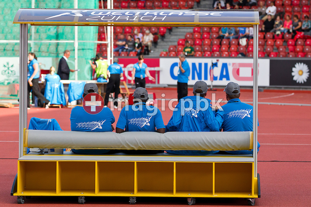 Volunteers sit on a bank prior to the IAAF Diamond League meeting at the Letzigrund Stadium in Zurich, Switzerland, Thursday, Aug. 19, 2010. (Photo by Patrick B. Kraemer / MAGICPBK)