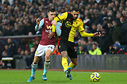 Watford midfielder Etienne Capoue (29) in a tussle for the ball with Aston Villa defender Frederic Guilbert (24) during the Premier League match between Aston Villa and Watford at Villa Park, Birmingham, England on 21 January 2020.