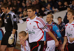 LONDON, ENGLAND - Wednesday, January 30, 2008: Liverpool's captain Steven Gerrard MBE leads his team out to face West Ham United during the Premiership match at Upton Park. (Photo by David Rawcliffe/Propaganda)
