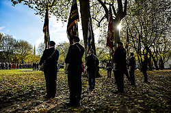 Royal British Legion standard bearers stand to attention while on parade during a Remembrance Sunday service in Queen's Square, Bristol, held in tribute for members of the armed forces who have died in major conflicts.