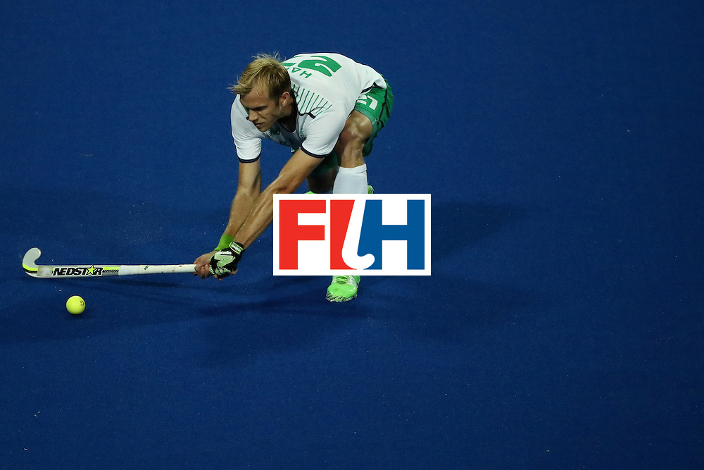RIO DE JANEIRO, BRAZIL - AUGUST 12:  Conor Harte #27 of Ireland passes against Argentina during a Men's Preliminary Pool A match on Day 7 of the Rio 2016 Olympic Games at the Olympic Hockey Centre on August 12, 2016 in Rio de Janeiro, Brazil.  (Photo by Sean M. Haffey/Getty Images)