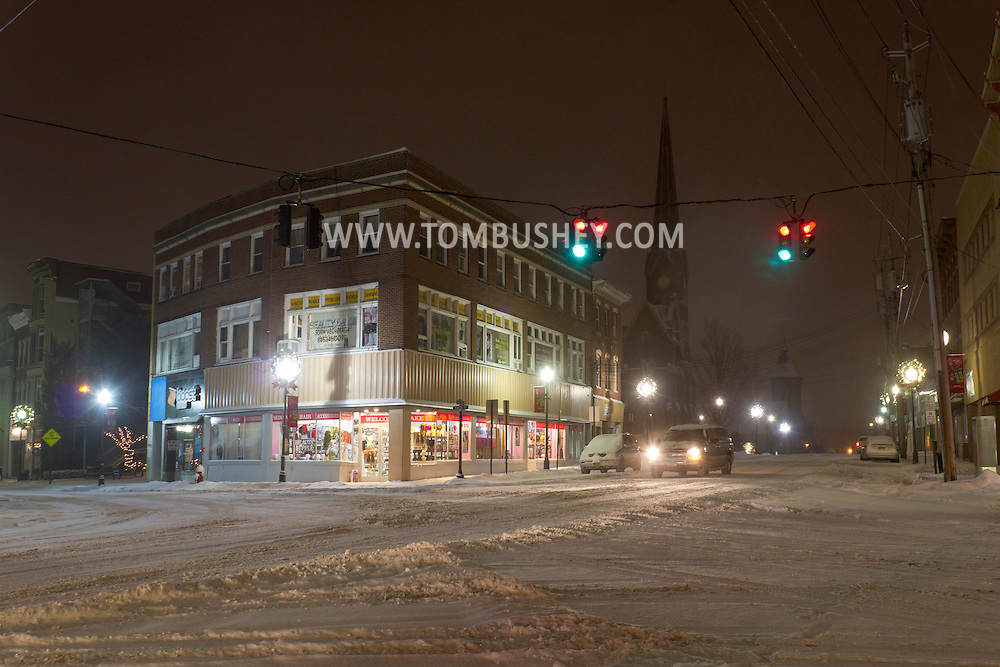 Middletown, New York - A car stops in the intersection at Franklin Square during a snowstorm on Dec. 22, 2013.