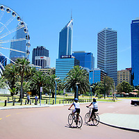 Cycling Past the Wheel of Perth at Barrack Square in Perth, Australia<br />
