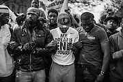 WASHINGTON, USA - APRIL 21: Men link arms in solidarity during a protest to seek justice for the death for Freddie Gray who died from injuries suffered in Police custody in Baltimore, USA on April 21, 2015.