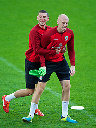 CARDIFF, WALES - Thursday, October 10, 2013: Wales' James Wilson and James Collins during a training session at the Cardiff City Stadium ahead of the 2014 FIFA World Cup Brazil Qualifying Group A match against Macedonia. (Pic by David Rawcliffe/Propaganda)