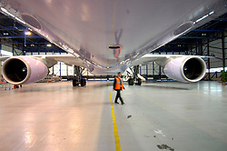 BRUSSELS, BELGIUM - MAY-23-2006 - Airplane maintenance in the SN Brussels Airlines hanger at Brussels National Airport. SN Brussels Airlines recently announced a merger with Virgin Express and that they will revamp their in-flight product on long haul flights connecting Europe and Africa. The three Airbus A330-300's in the SN Brussels fleet will feature flatbeds in Business class as well as enhanced audio and video entertainment packages. Economy class also received an upgrade with new ergonomically designed seats and new LCD video screens. (PHOTO © JOCK FISTICK)