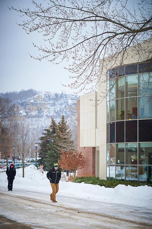 Activity; Walking; Buildings; Murphy Library; Location; Outside; Objects; Bluffs; People; Man Men; Student Students; Type of Photography; Candid; Time/Weather; day; snowy; Winter; January; UWL UW-L UW-La Crosse University of Wisconsin-La Crosse