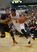 Dec 19, 2013; Long Beach, CA, USA; Long Beach State 49ers guard Mike Caffey (5) is defended by Southern California Trojans guard Chass Bryan (3) at Walter Pyramid. Long Beach State defeated USC 72-71.