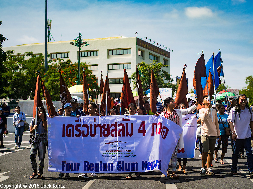03 OCTOBER 2016 - BANGKOK, THAILAND:  Marchers go past the UN building in Bangkok during a World Habitat Day protest. In 1985, the UN General Assembly declared that World Habitat Day would be observed on the first Monday of October every year.  The declaration noted that every person deserves a decent place to live. In Bangkok this year, hundreds of people marched to the United Nations' offices to deliver a letter addressed to the UN Secretary General noting that forced evictions to facilitate urban renewal and gentrification was resulting in an increase in homelessness and substandard housing. Protesters and housing rights' activists also marched to the Prime Minister's Office and Bangkok city hall to express their concerns.     PHOTO BY JACK KURTZ