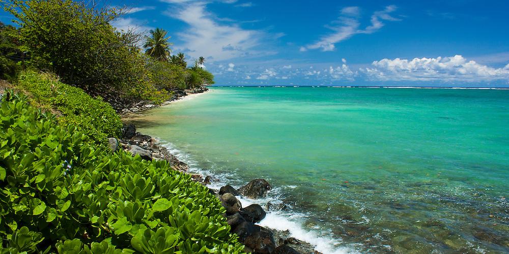 Ocean rocks and surf on windward coast of Oahu, Hawaii at Punaluu