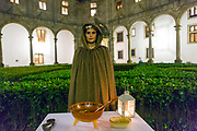 SANTIAGO DE COMPOSTELA, SPAIN - 11th of October 2017 - A lady performs the traditional culinary ritual of the Galician Queimada spell in Santiago de Compostela. Rooted in Celtic tradition, the flaming queimada drink of Galicia is believed to ward off evil spirits. Galicia, Spain.